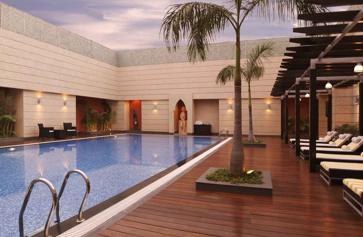 Lemon tree hotels hyderabad for Resorts with private swimming pool in hyderabad